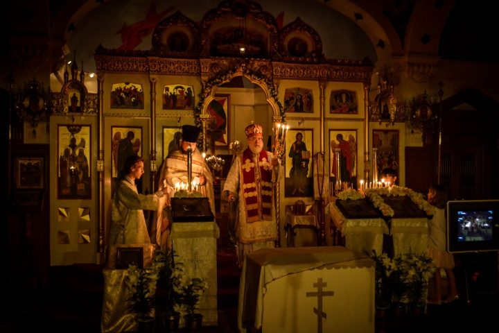 Fr Kirill and family lighting candles on behalf of all of our faithful